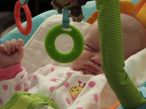 The bouncy chair can wear a girl out. [Note the little hand sticking up...]